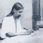 Picture of Sri Aurobindo writing